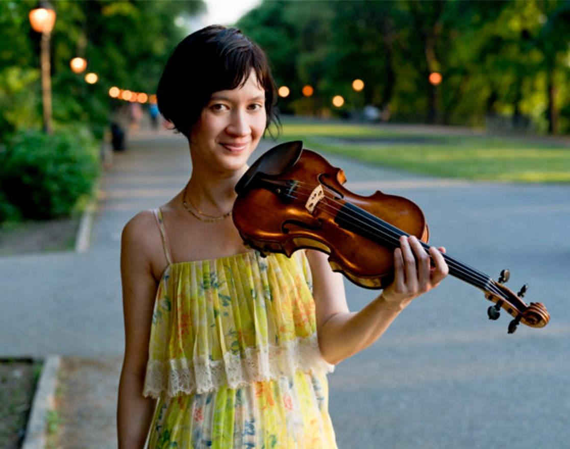 woman smiling with violin