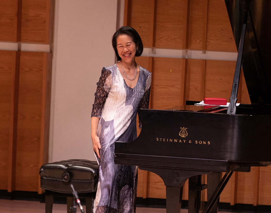 donna weng friedman stands up after performing piano at merkin hall